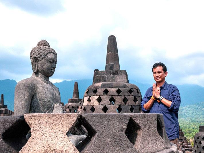 Indonesia Tourist Praying at Borobudur Temple in Yogyakarta