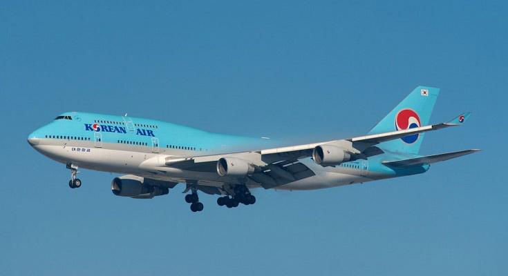 Korean Airlines plane in flight in cloudless blue skies